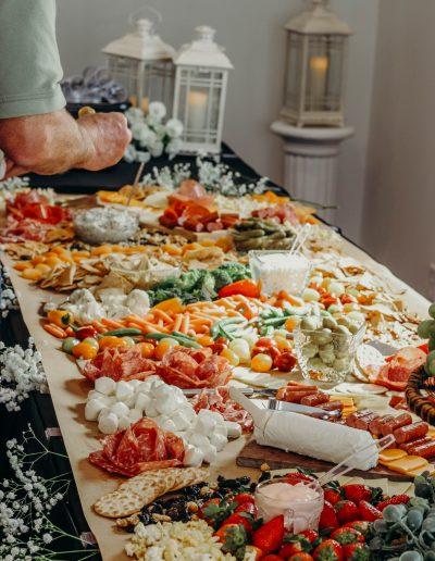 Graze table at barn wedding venue. Graze food table at white barn wedding venue