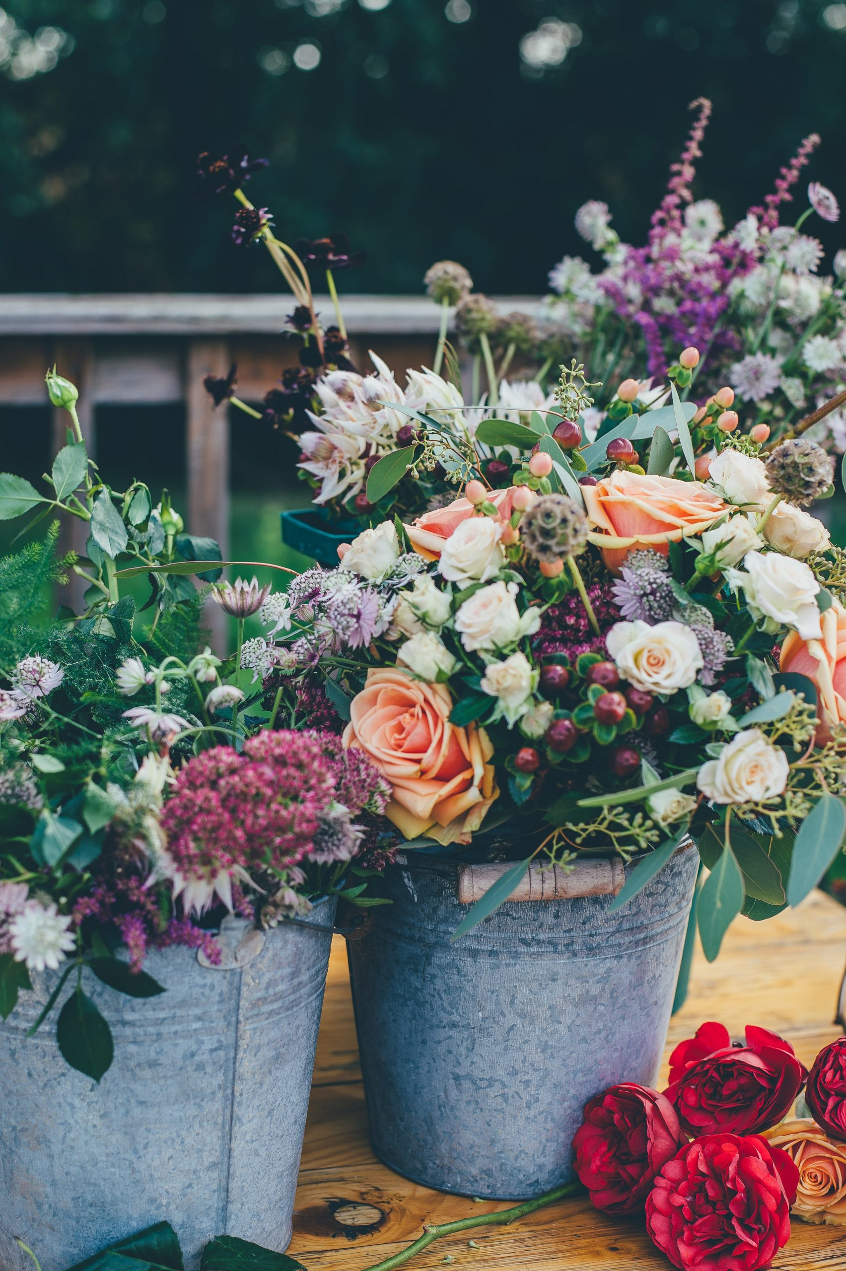 beautiful summer florals in beautiful white barn wedding venue in east tennessee